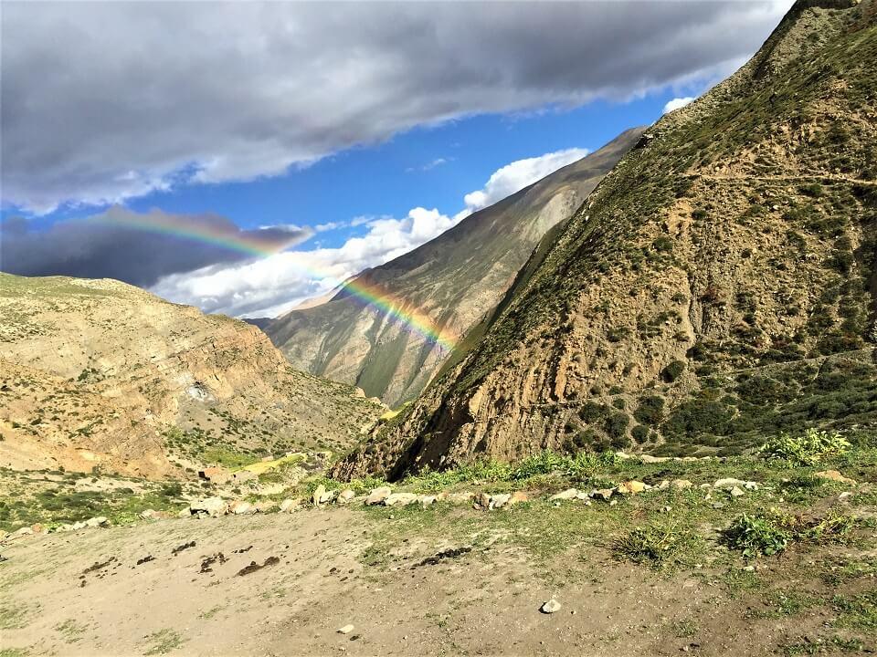 Upper Dolpo trek – rainbow above land scape in Dolpo region